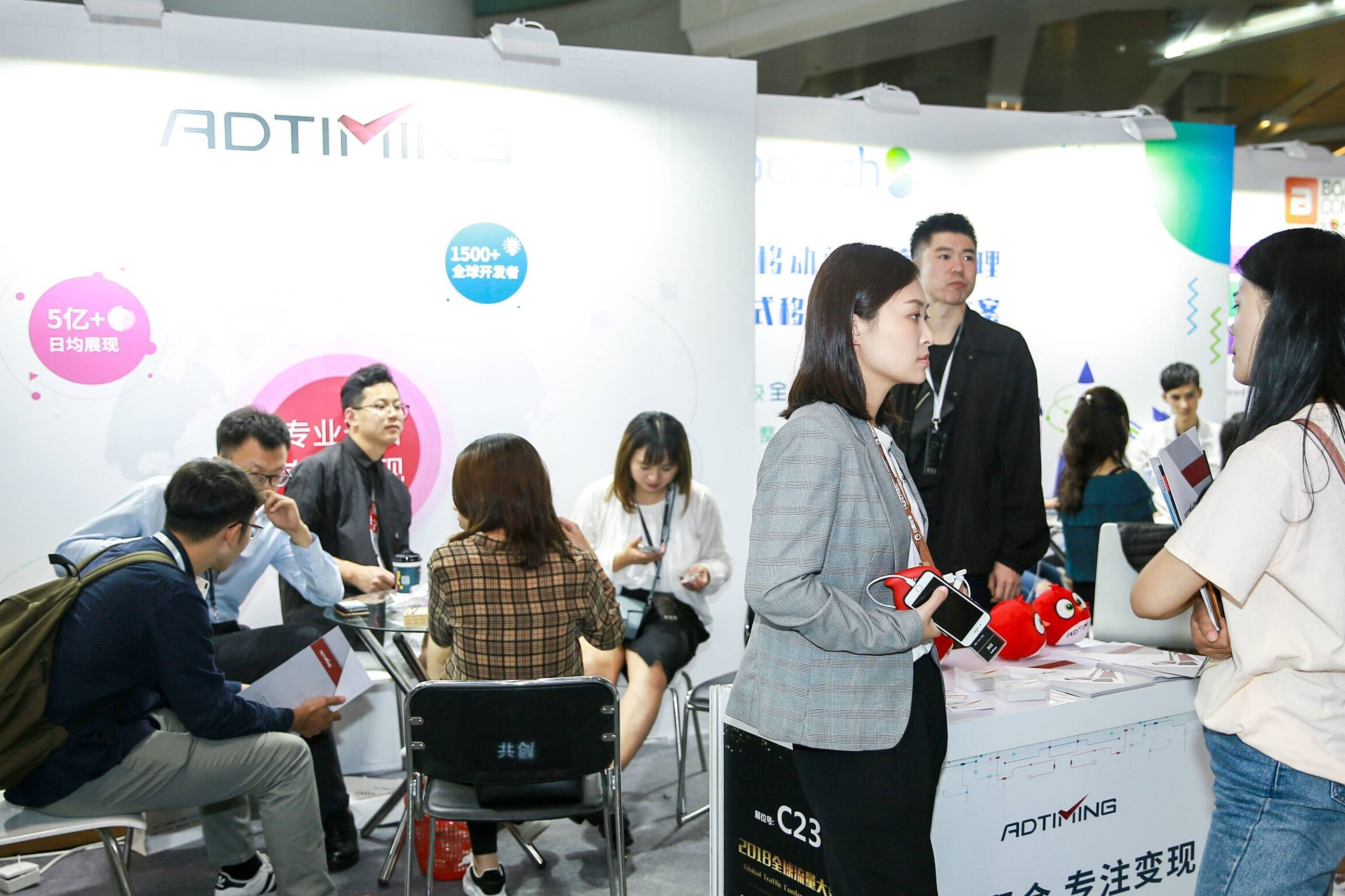 Visitors at the AdTiming Global Traffic Conference Booth
