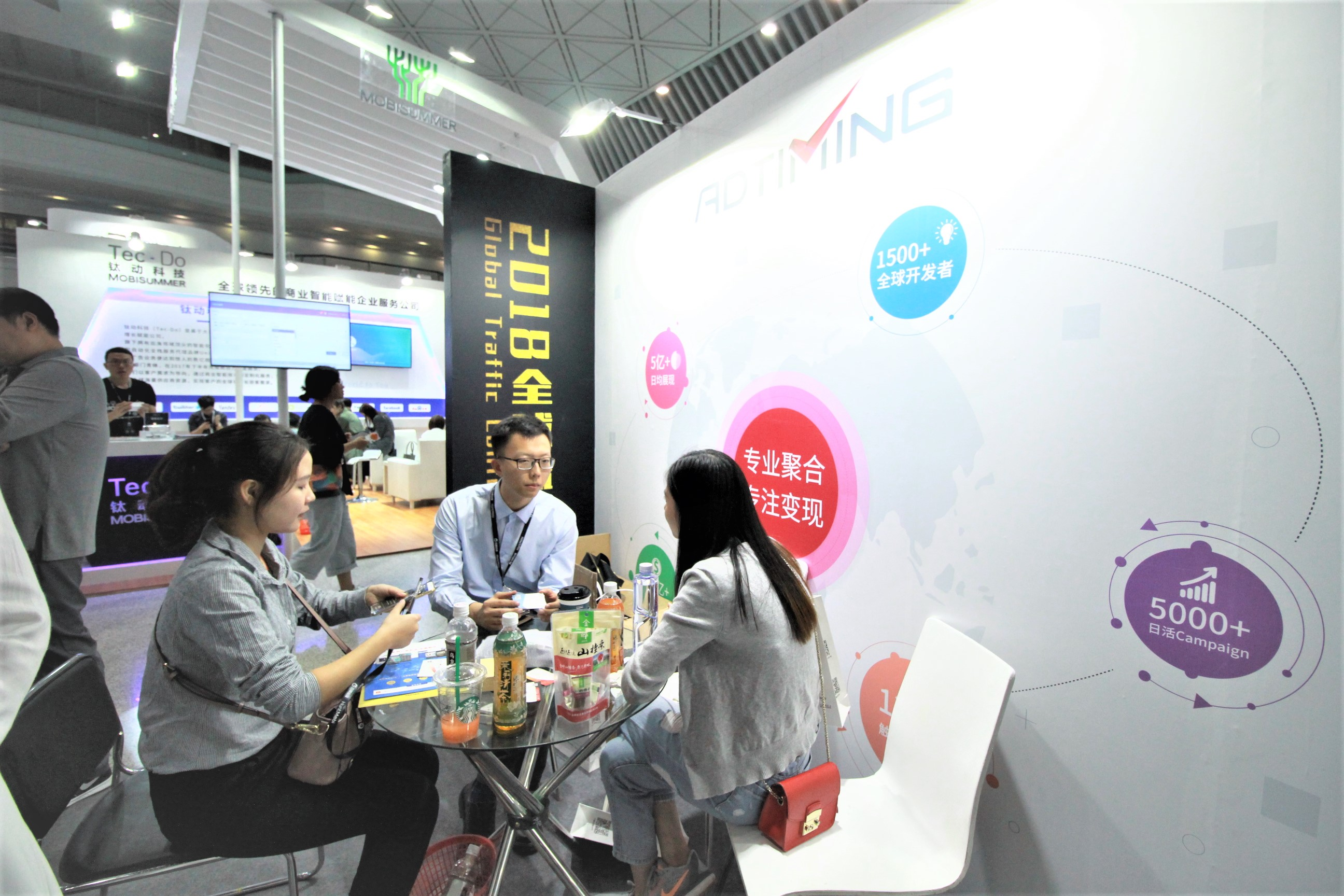 Discussion at the AdTiming Global Traffic Conference Booth